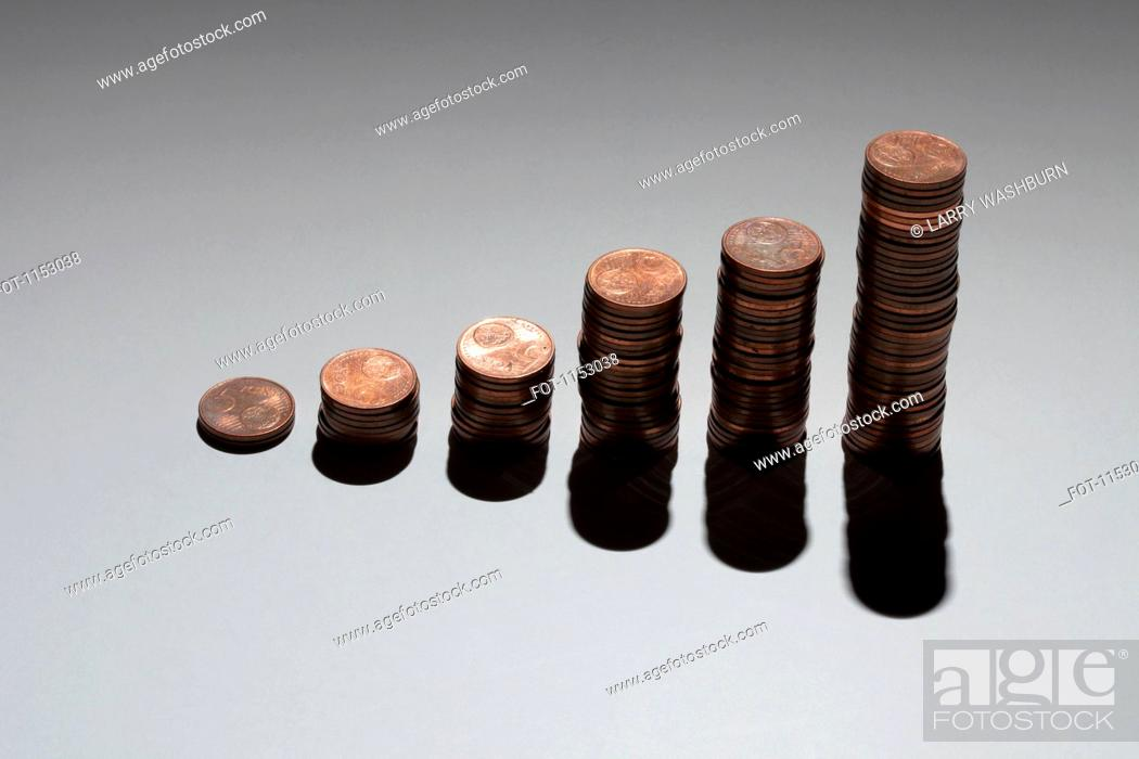 Stock Photo: Rows of stacks of five cent Euro coins increasing in size.