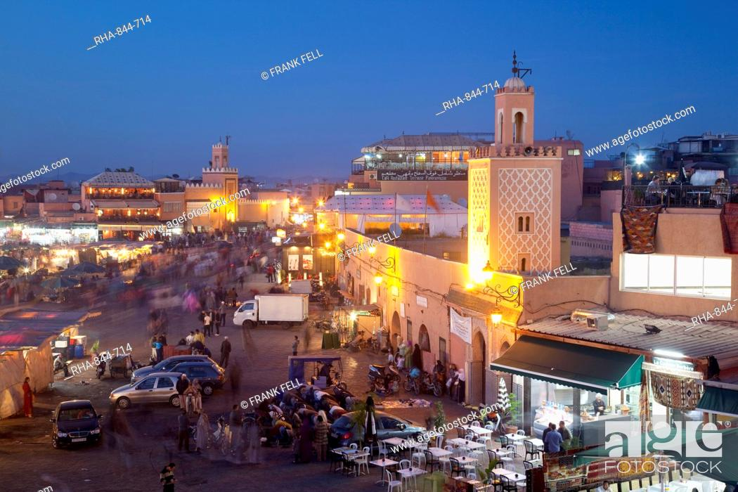 Stock Photo: View over market square at dusk, Place Jemaa El Fna, Marrakesh, Morocco, North Africa, Africa.