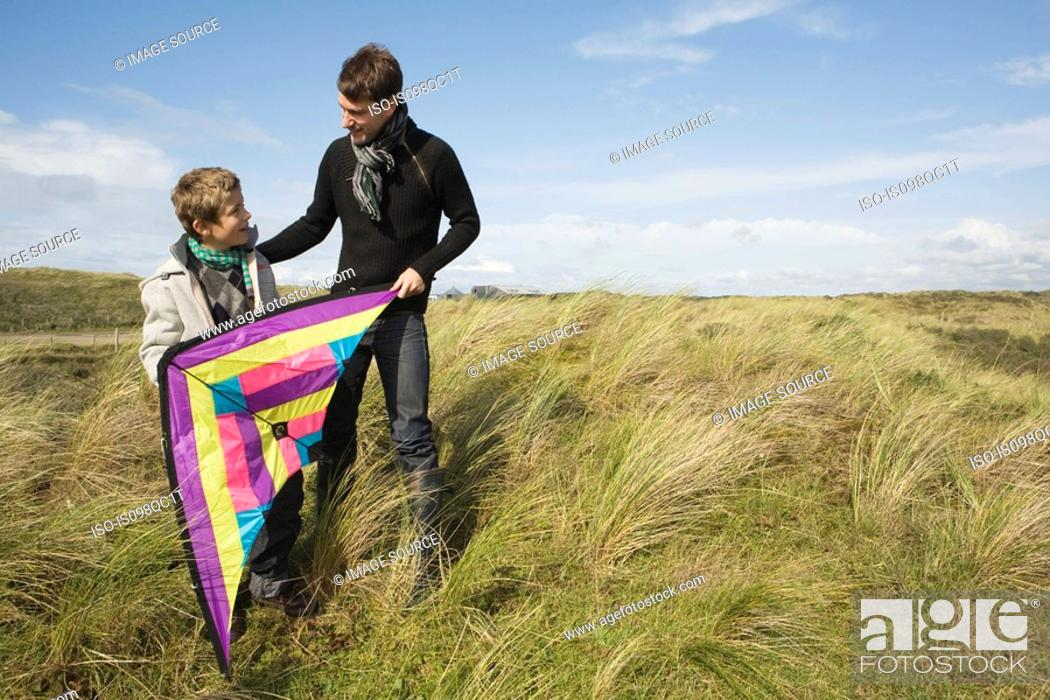 Stock Photo: Father and son with kite.