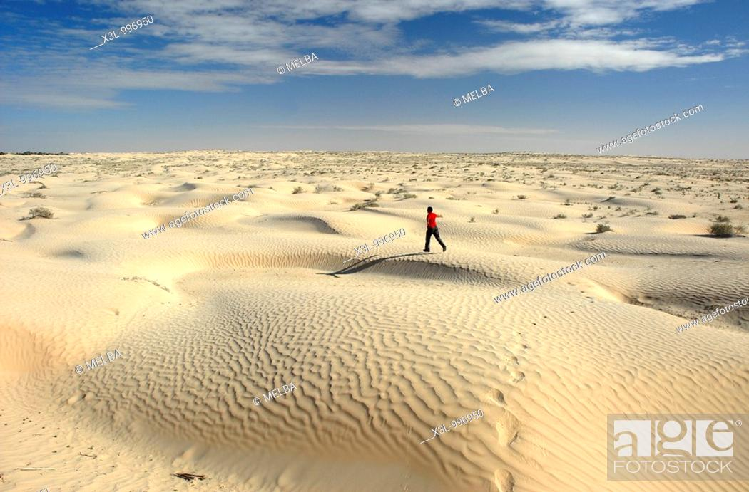 Stock Photo: Happy man running in Douz desert  Tunisia.