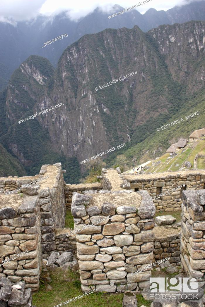 Stock Photo: Detail of the ruins of Machu Picchu with a view of the mountain.