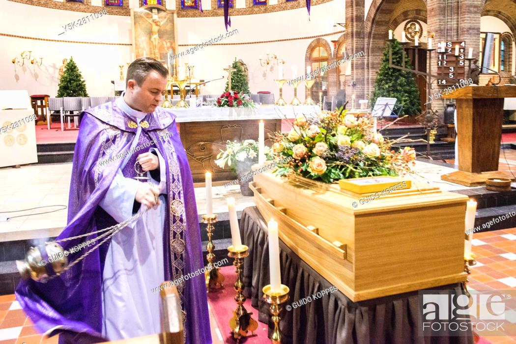 Stock Photo: Geldrop, Netherlands. Catholic funeral ceremony prior to the burrial of a deceased person.