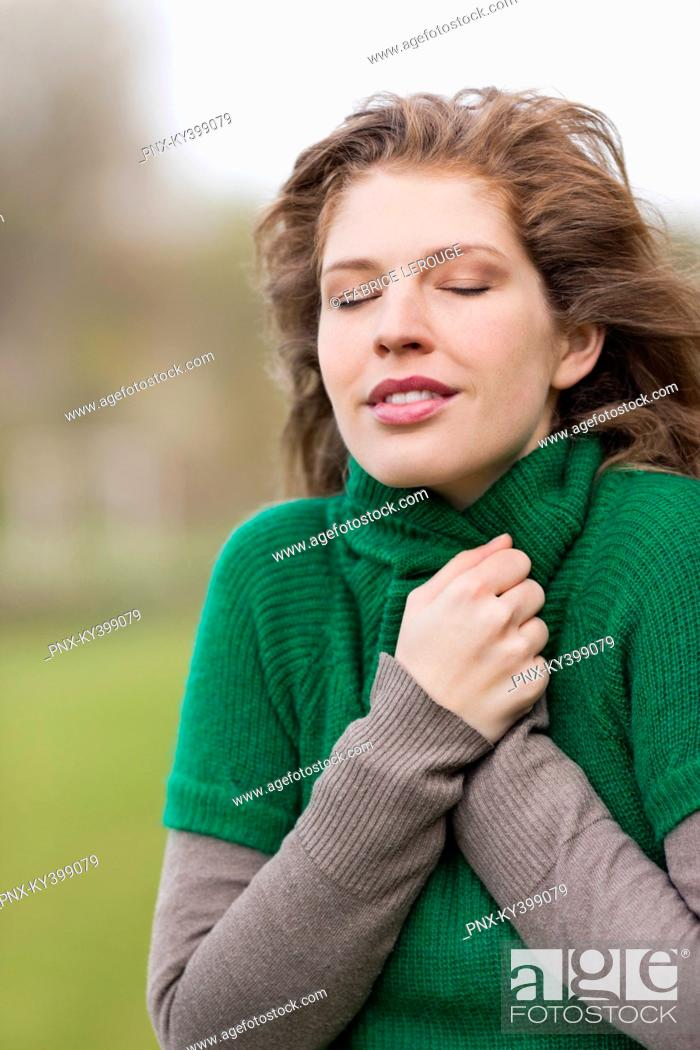 Stock Photo: Close-up of a woman shivering.