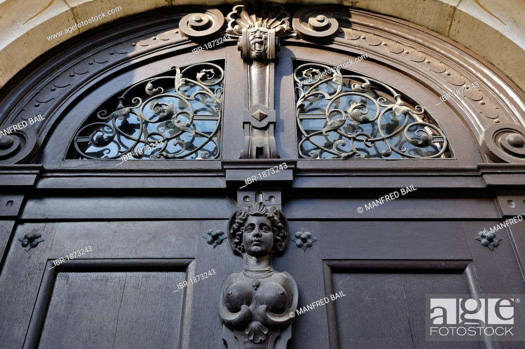 Stock Photo: Old wooden door with a female figure, Prinzregentenstrasse, Munich, Bavaria, Germany, Europe.