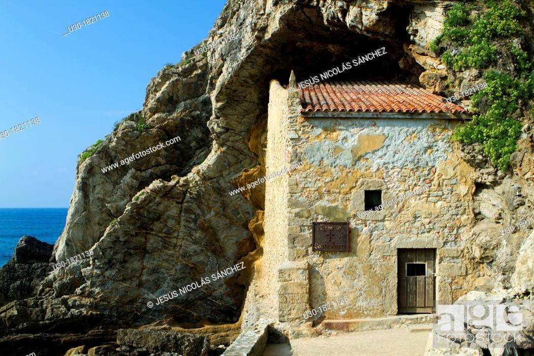 Stock Photo: The small Santa Justa Chapel, embedded into the cliff  Santa Justa beach, Ubiarco village  Santillana del Mar  Cantabria  Spain.