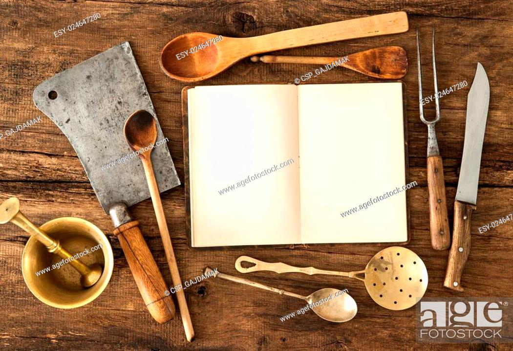 Stock Photo: Cookbook and kitchen utensils.