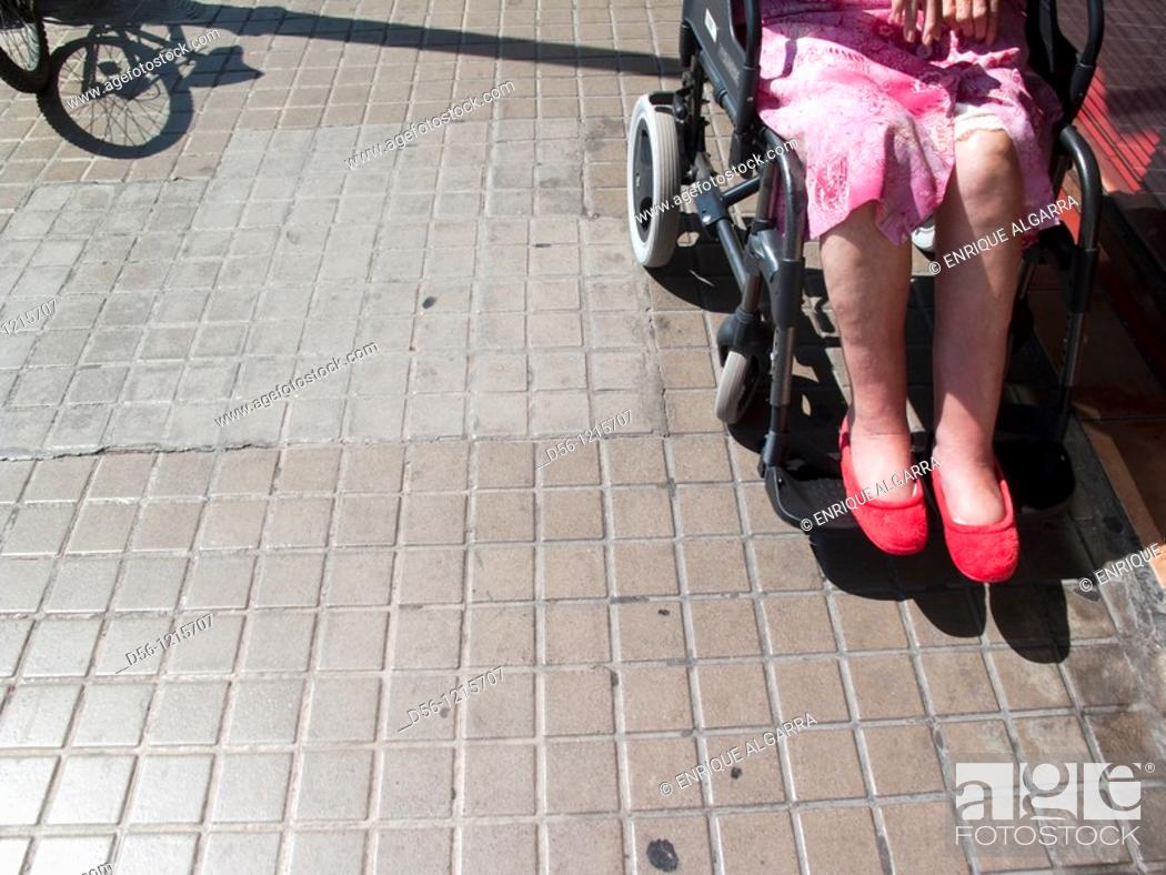Stock Photo: woman on a wheelchair.