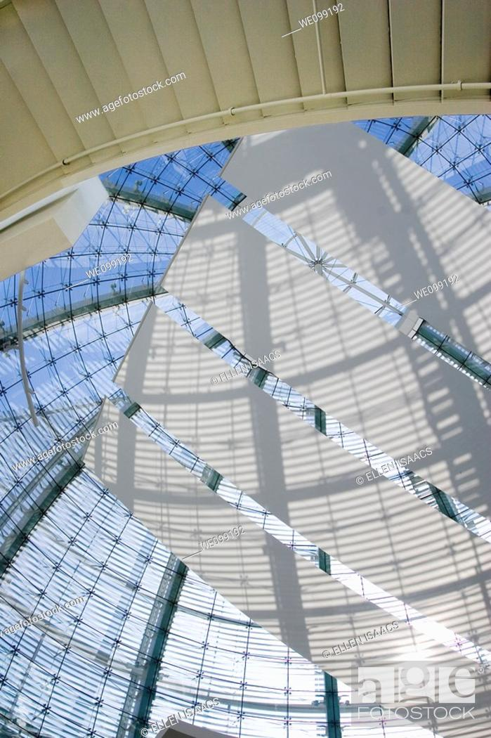 Stock Photo: Looking up at the glass dome of the San Jose City Hall rotunda building  The shadows are making patterns on the sails stretching across the dome as the sun.