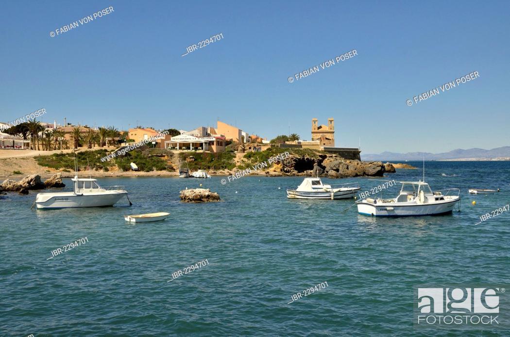 Stock Photo: Boats in the harbour of the Island of Tabarca, church Iglesia de San Pedro at back, Isla de Tabarca, Costa Blanca, Spain, Europe.