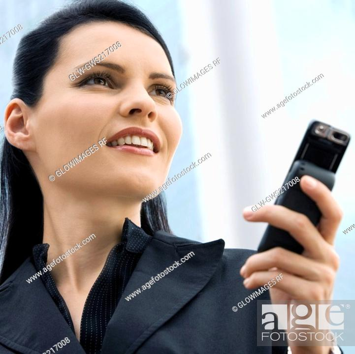 Stock Photo: Close-up of a businesswoman using a mobile phone.