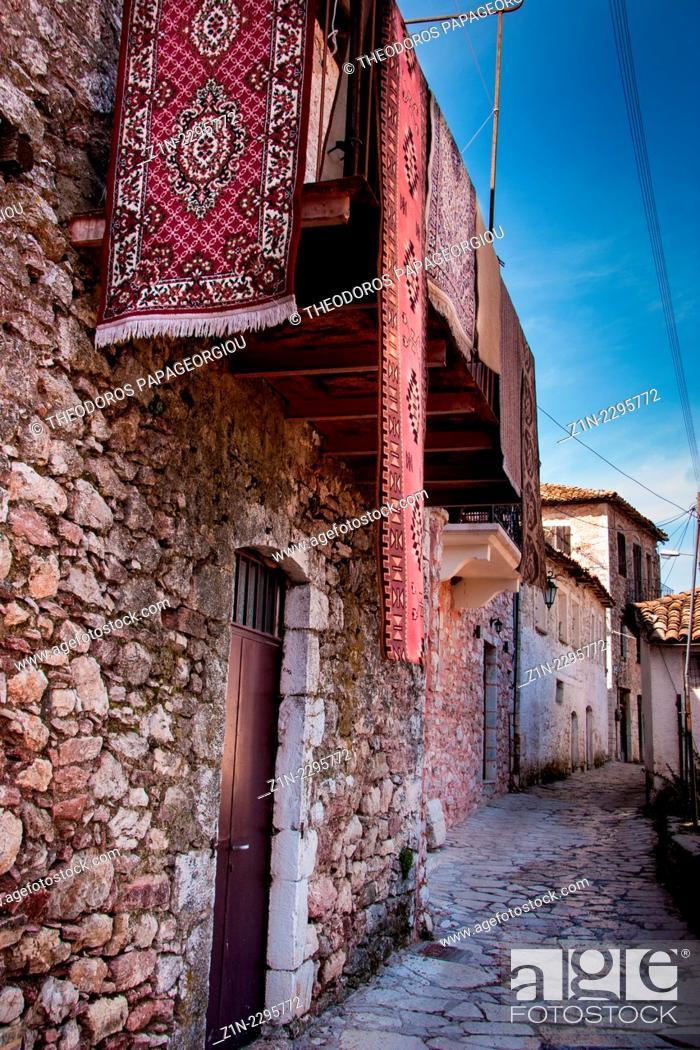 Stock Photo: Carpets on a balcony over an alley. Dimitsana town, Arcadia, Peloponnese, Greece.