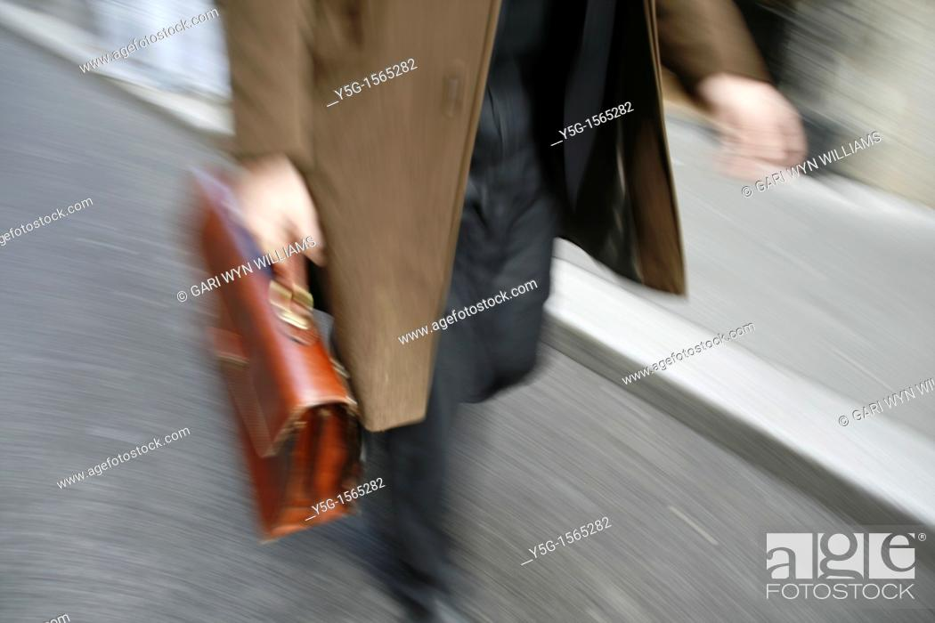 Stock Photo: commuter with briefcase in town in rome italy.