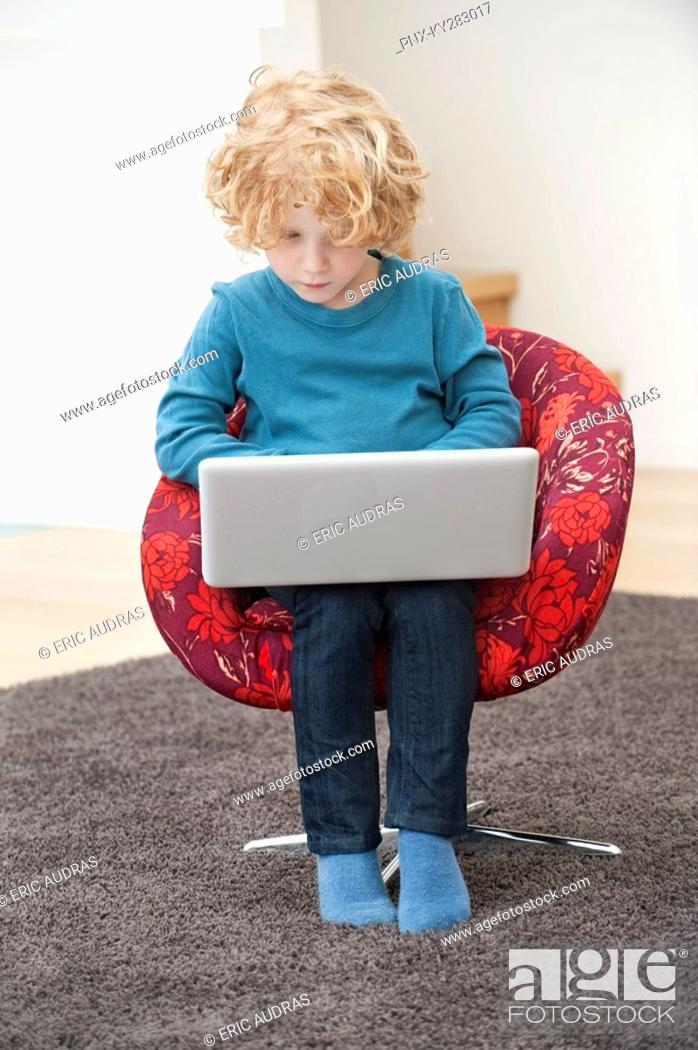 Stock Photo: Boy using a laptop.