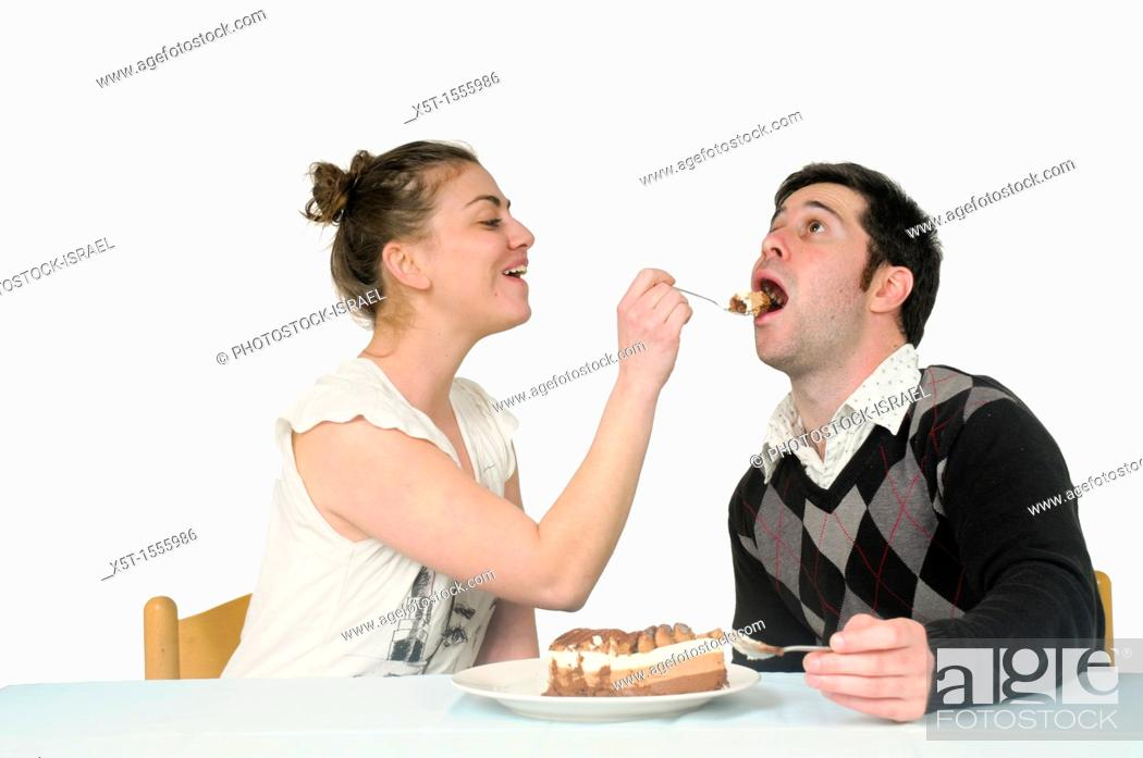 Stock Photo: Woman feeds cream cake to a man.