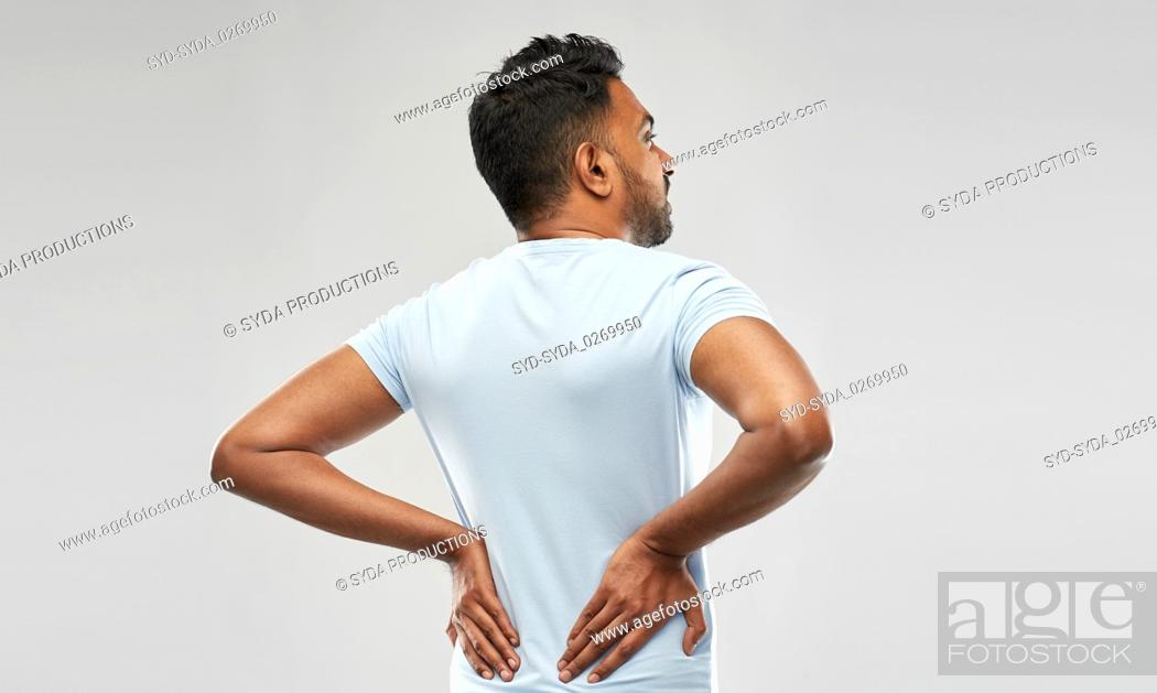 Stock Photo: indian man suffering from backache.