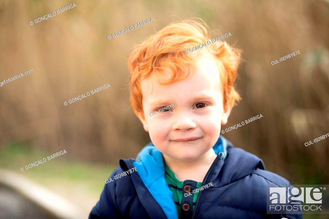 Stock Photo: Portrait of boy with red hair.