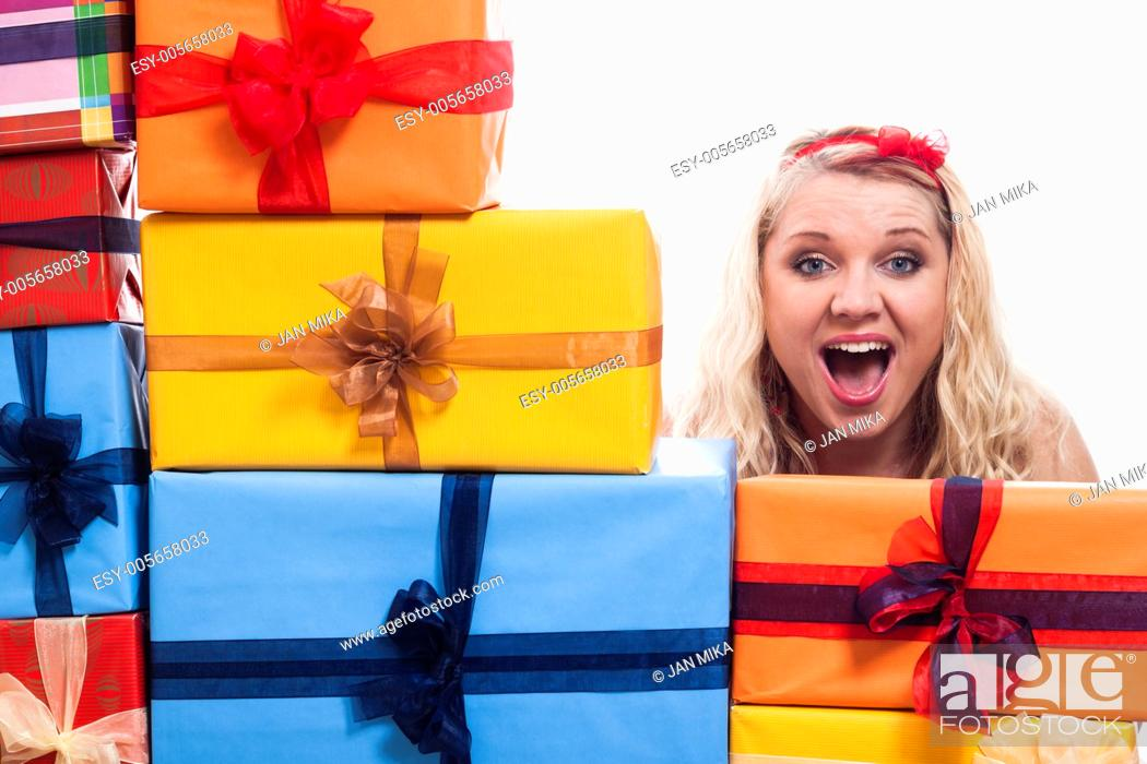 Stock Photo: Shocked woman with many presents, isolated on white background.