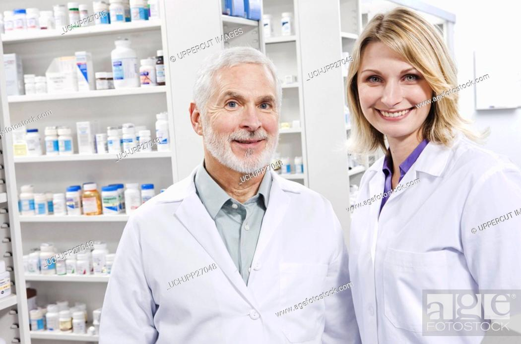 Stock Photo: Portrait of two smiling pharmacists.