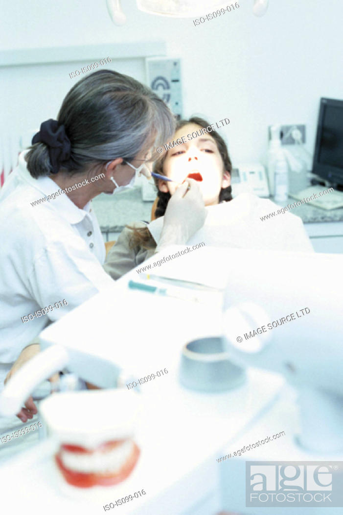 Stock Photo: Girl being examined by dentist.