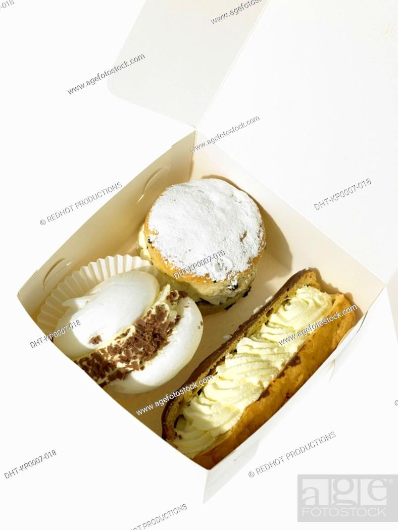 Stock Photo: Cream Cakes in take out packaging.