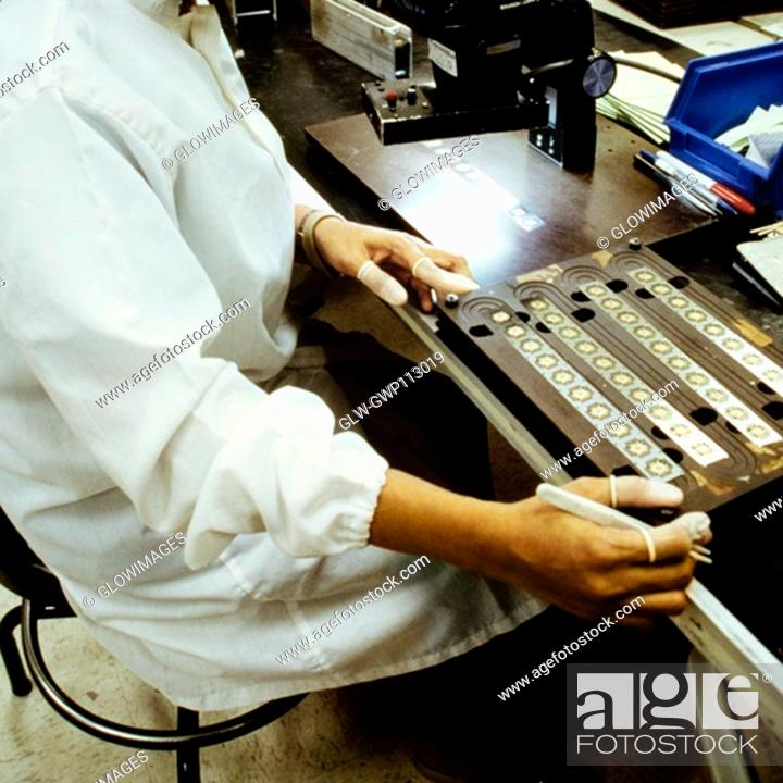 Stock Photo: Mid section view of a man working in an electronic industry, Singapore.