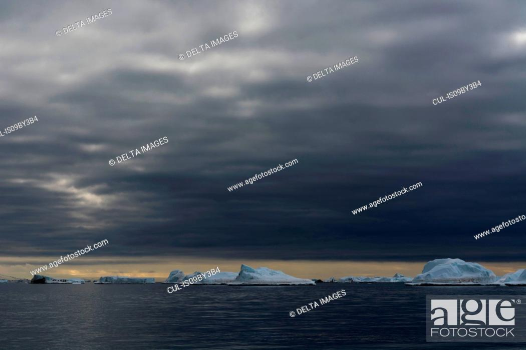 Stock Photo: Icebergs under storm clouds, Vibebukta, Austfonna, Nordaustlandet, Svalbard, Norway.