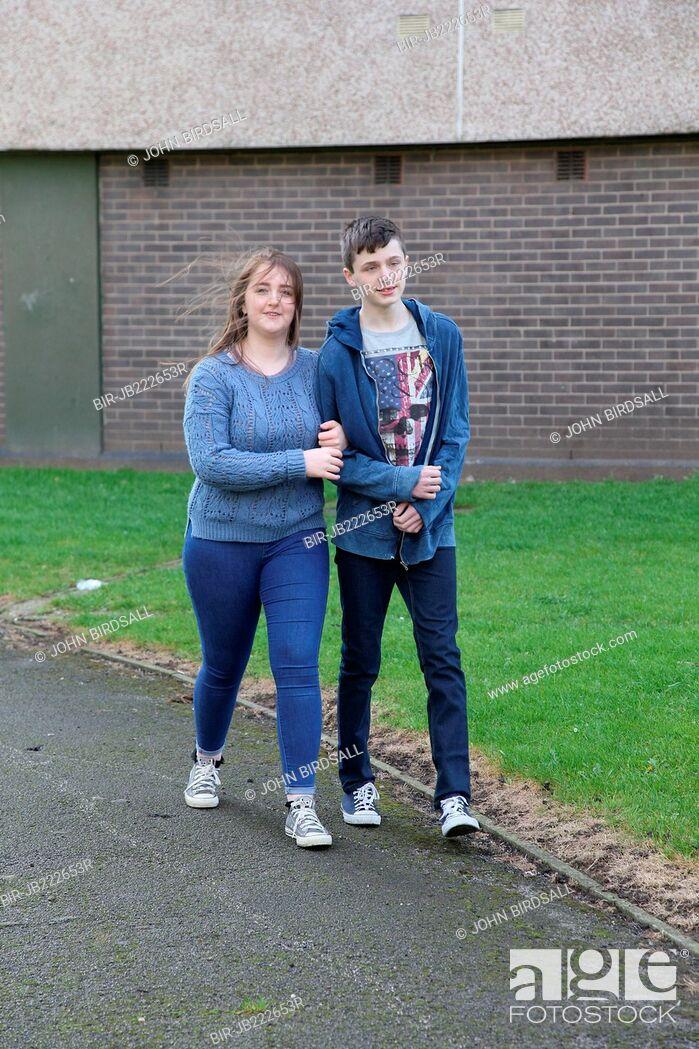 Stock Photo: Teenage couple walking arm in arm.