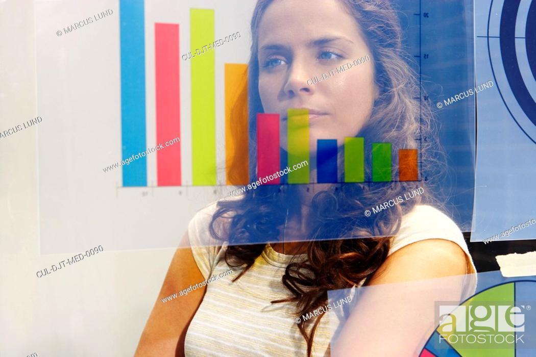 Stock Photo: Young woman seen through graph.