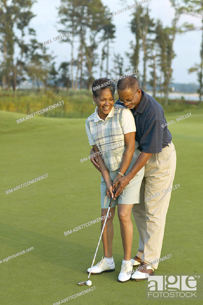Stock Photo: Senior couple playing golf.