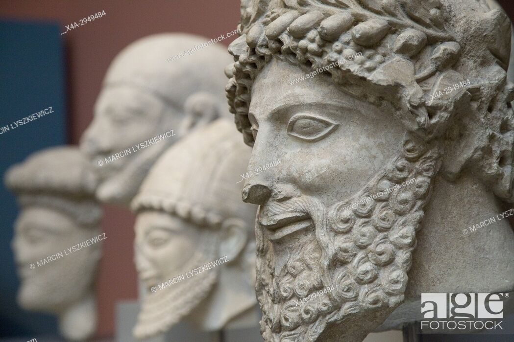 Stock Photo: Ancient Sculptures of Men Heads, British Museum, London, England, United Kingdom.