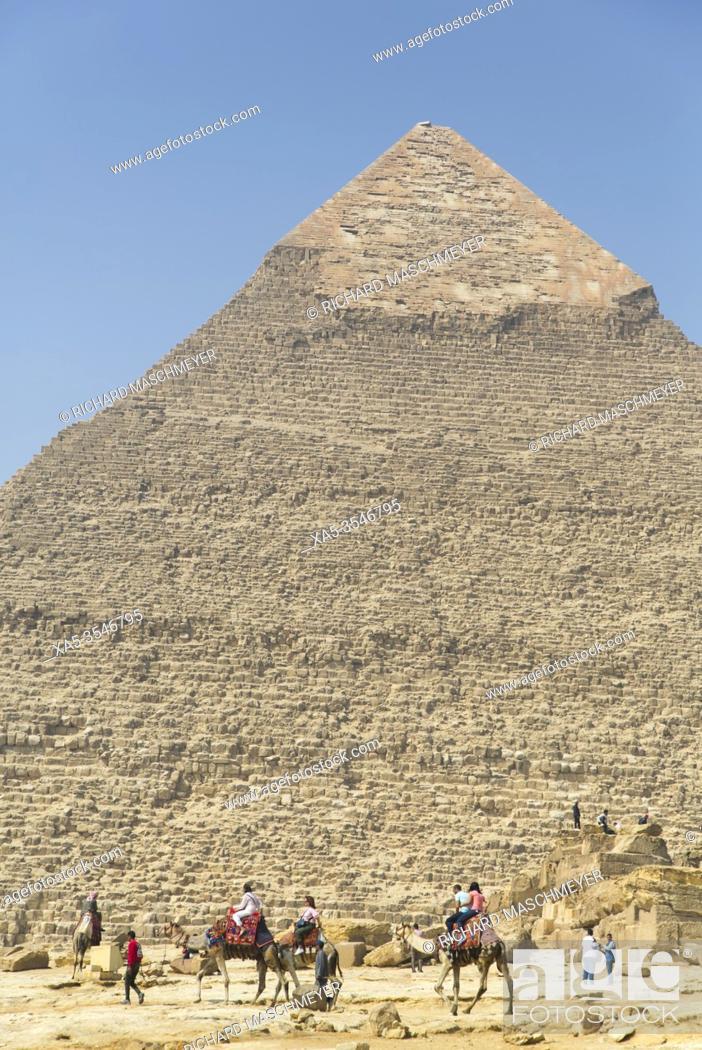 Stock Photo: Tourists Riding Camels, Khafre Pyramid (background), Great Pyramids of Giza, UNESCO World Heritage Site, Giza, Egypt.