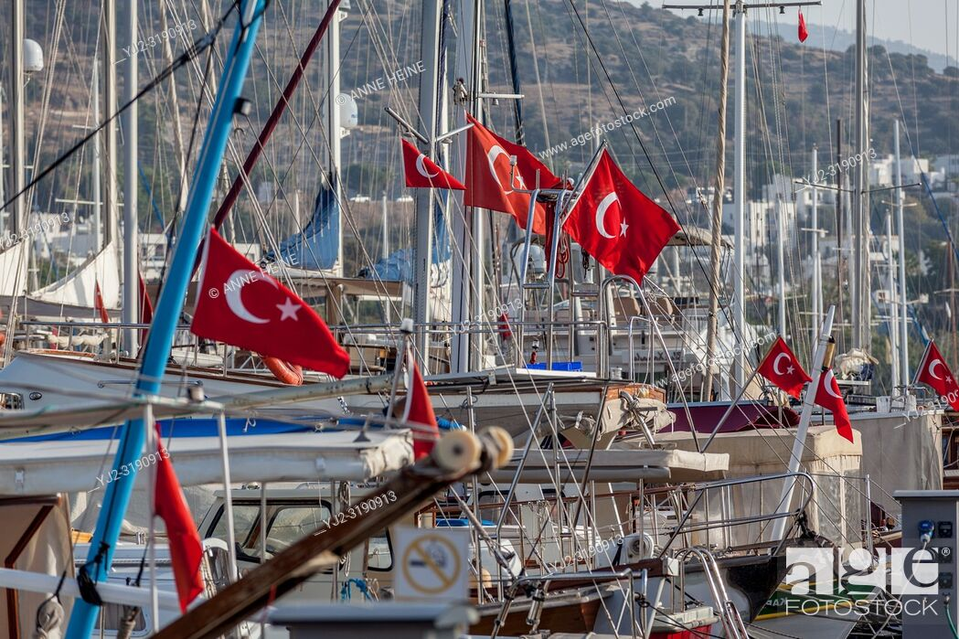 Stock Photo: Turkish flags on boats in Bodrum harbour, Turkey.