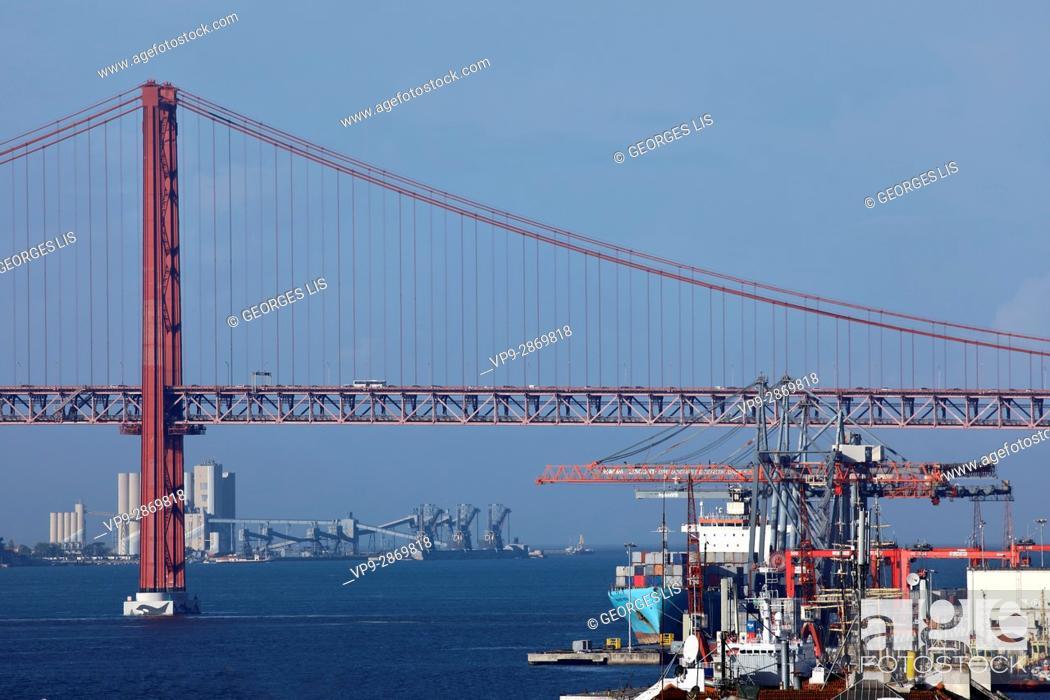 Stock Photo: iron suspension 25 de Abril bridge Tagus Tejo crane harbour Lisbon Portugal.