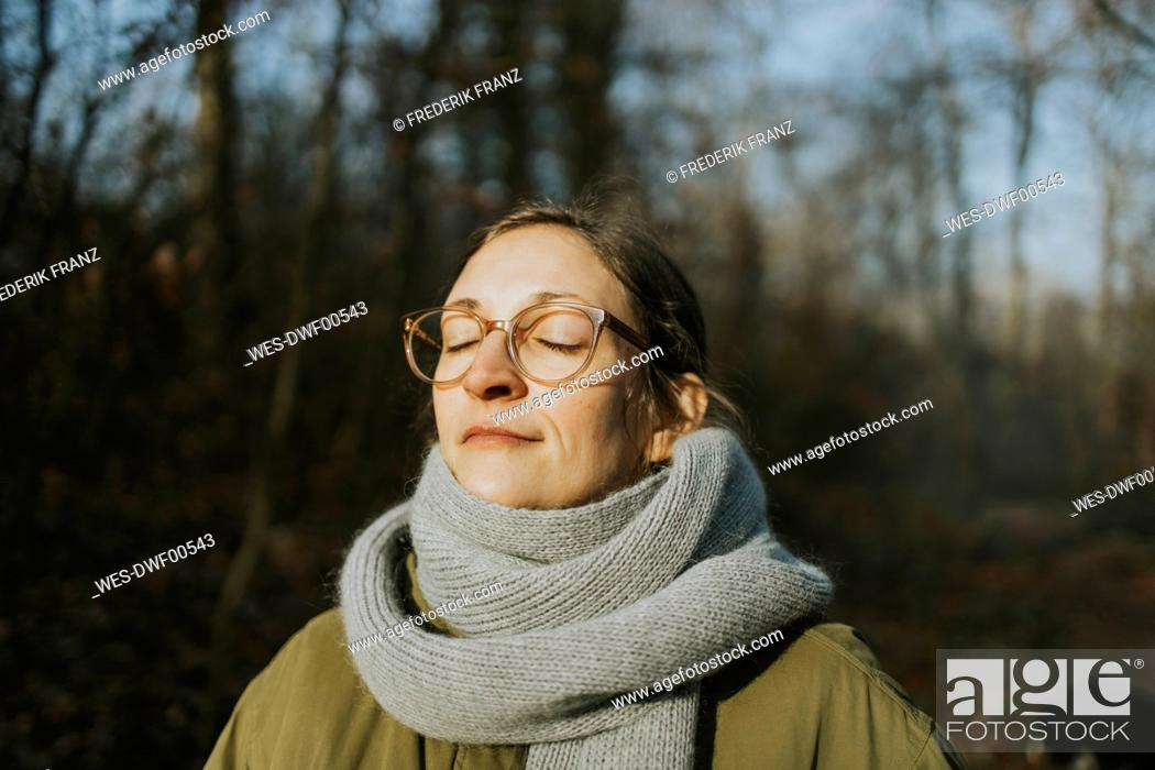 Photo de stock: Portrait of woman during sunbath in winter.