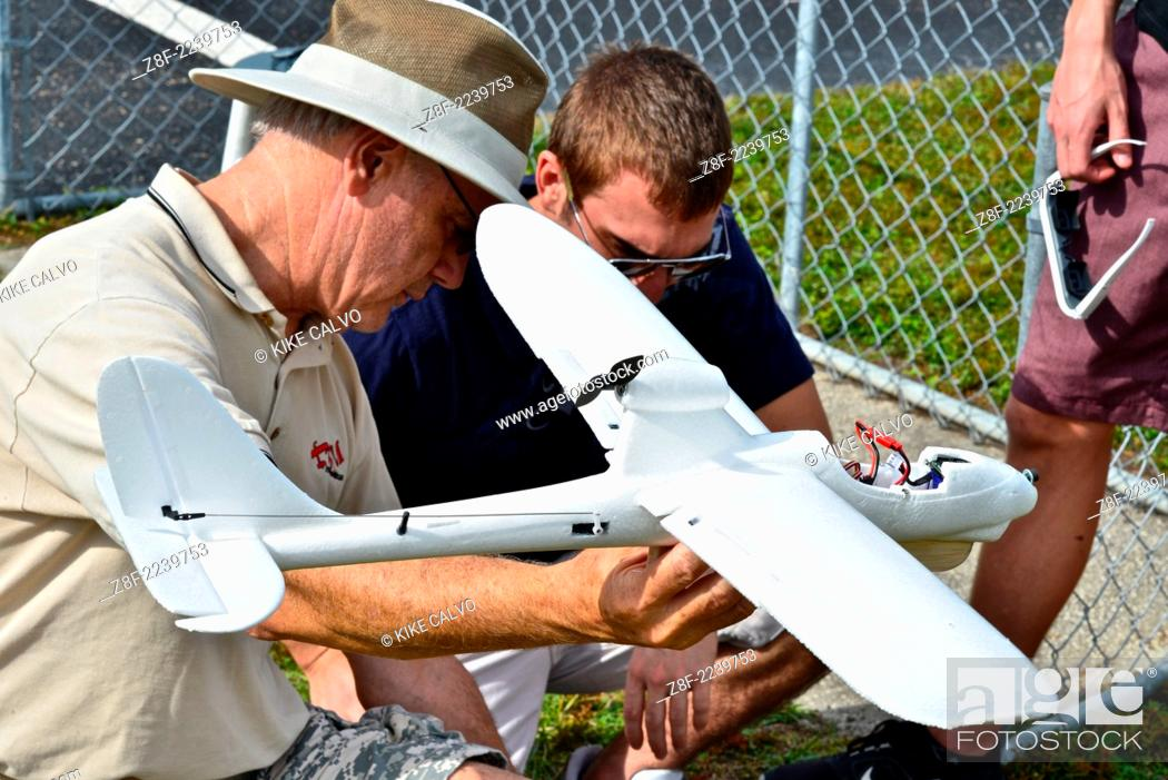Stock Photo: Students learn to fly fixed-wing RC planes at a small unmanned aircraft pilot training course at the Unmanned Vehicle University.