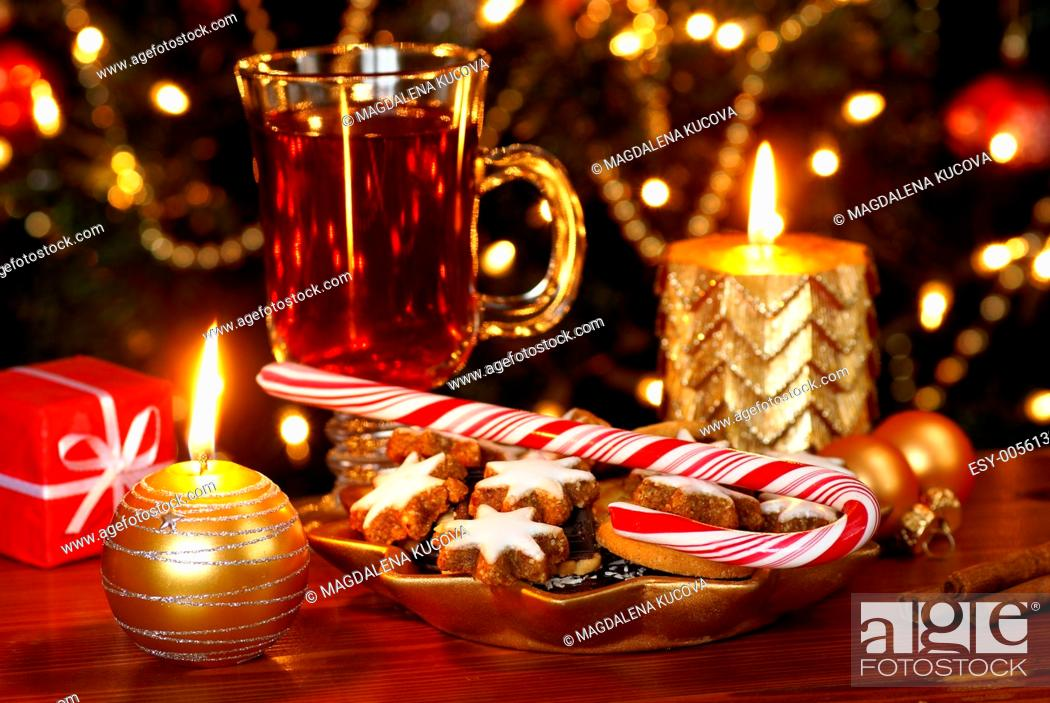 Stock Photo: Christmas cookies and candy cane with tea and Christmas decorations.