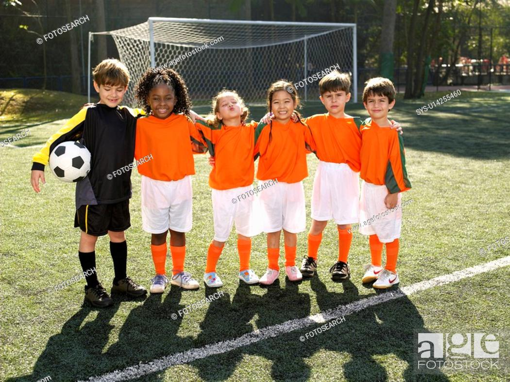 Stock Photo: Children standing in soccer field portrait.