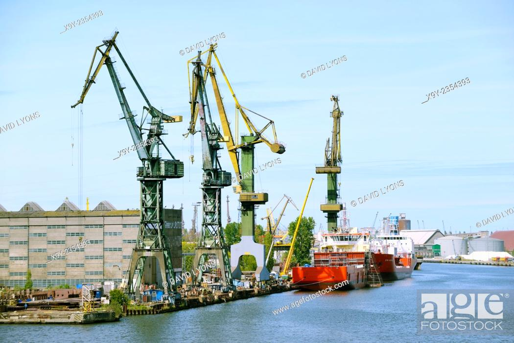 Stock Photo: Gdansk Poland. Port dock facilities and warehouses of Stocznia Gdansk S.A. on south tip of Ostrow Island.