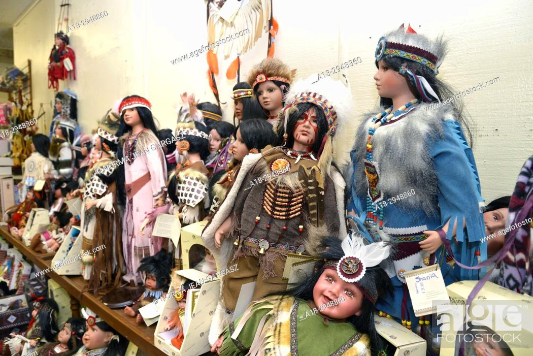 Stock Photo: Dolls depicting Native Americans, or Indians, are for sale at The Thing, a travel service station and souvenir shop along Interstate 10, near Willcox, Arizona.
