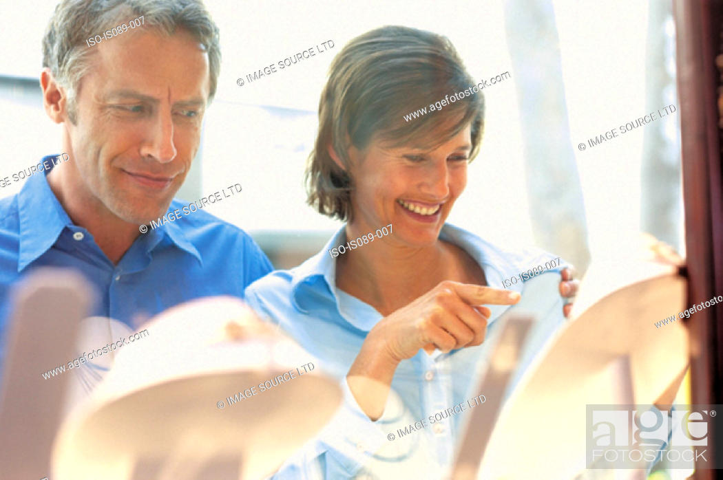 Stock Photo: Man and woman window shopping.