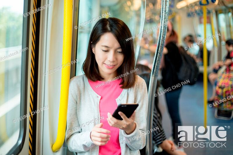 Stock Photo: Woman use of mobile phone in train.