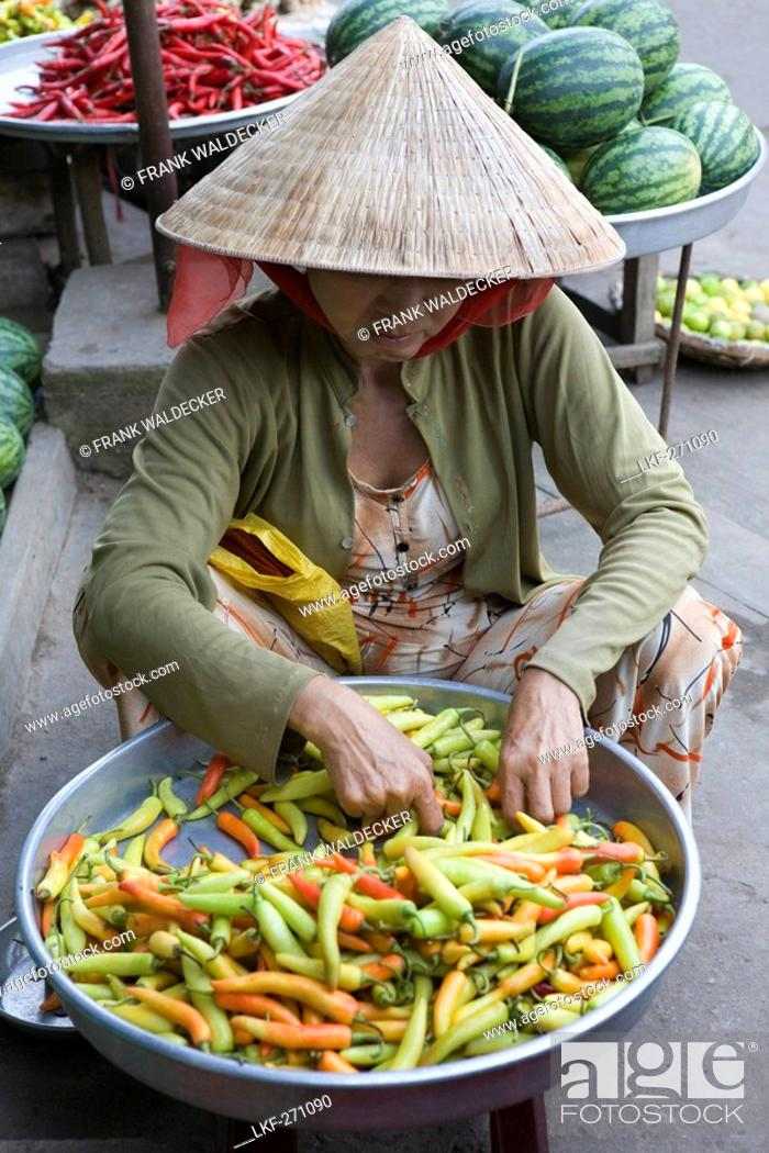 Stock Photo: Vietnamese woman at the market at Cai Rang, Mekong Delta, Can Tho Province, Vietnam, Asia.