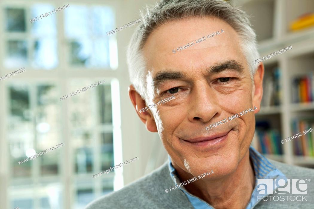 Stock Photo: Germany, Berlin, Senior man smiling, portrait.