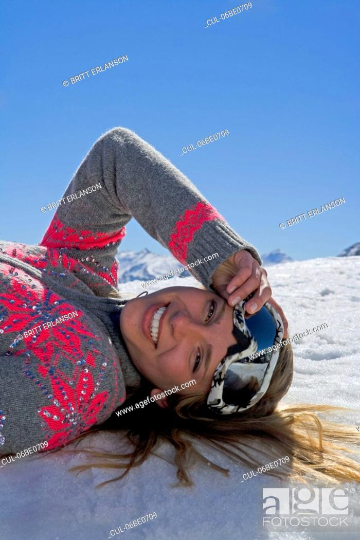 Stock Photo: Girl laying on snow.