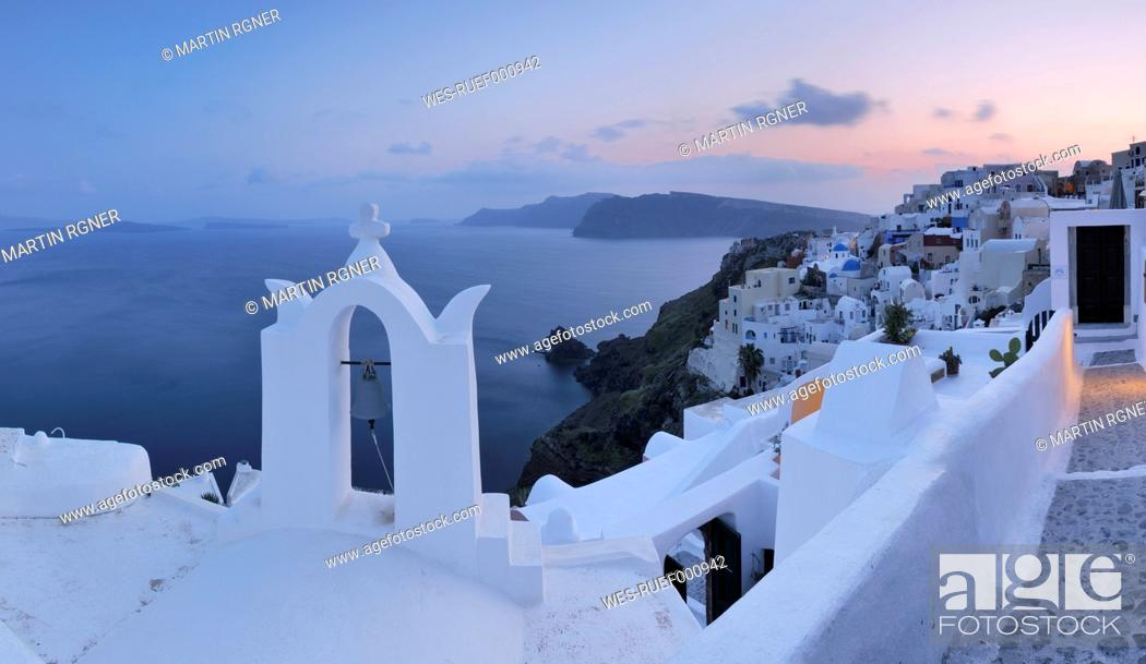 Stock Photo: Greece, View of Oia village with bell tower at Santorini.