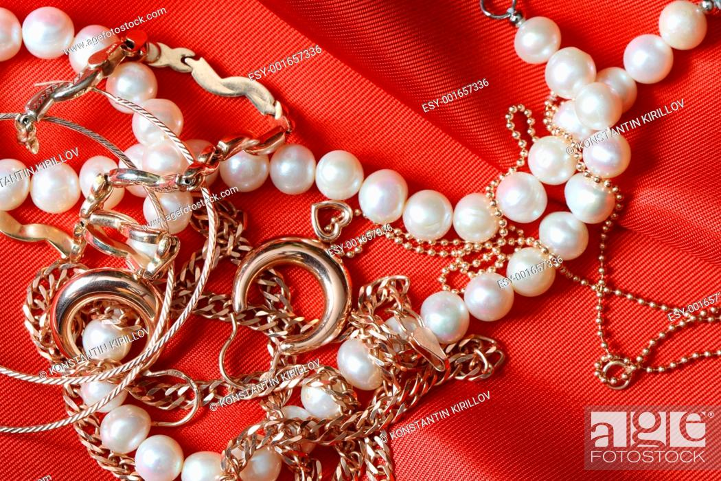 Photo de stock: Jewelry On Red.