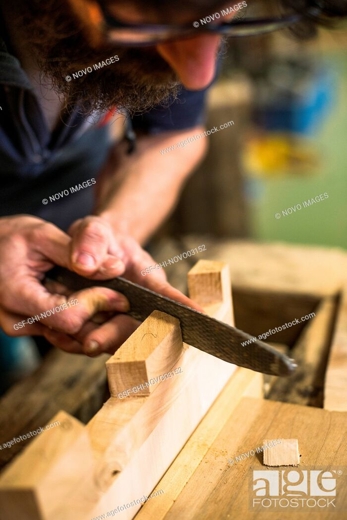 Imagen: Woodworker Using Rasp on Piece of Wood, High Angle View.