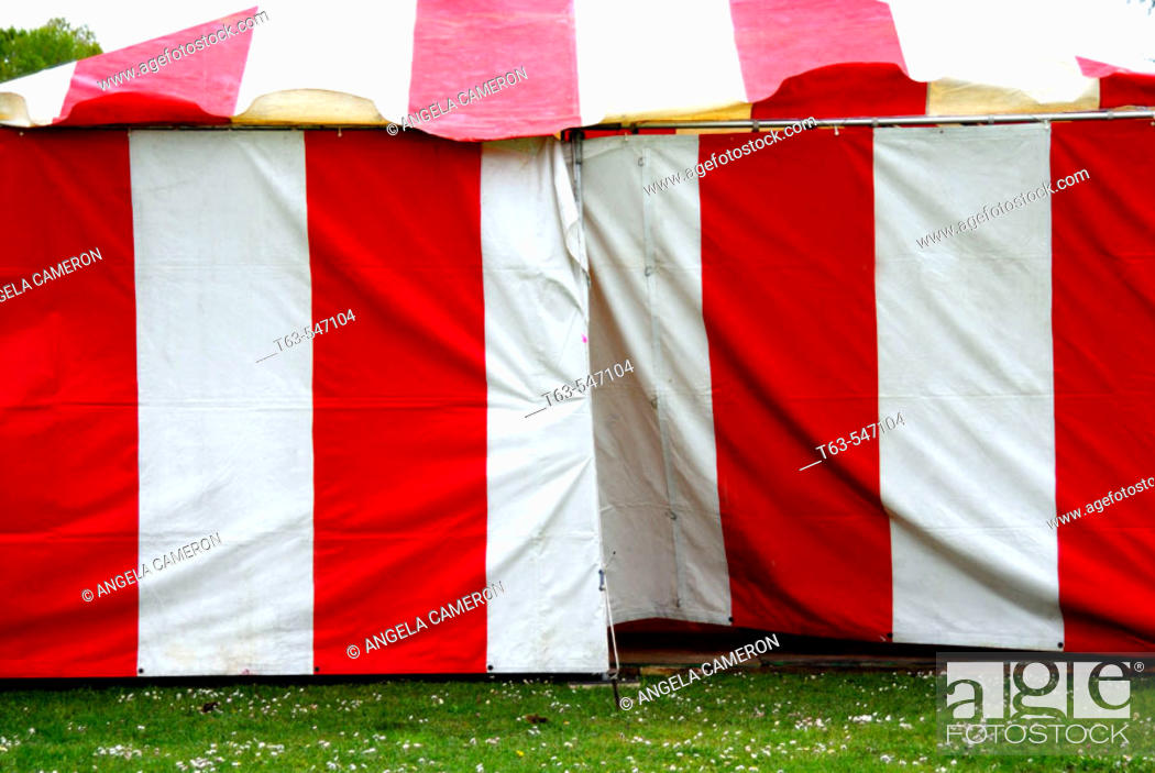 Stock Photo: red and white striped circus tent.