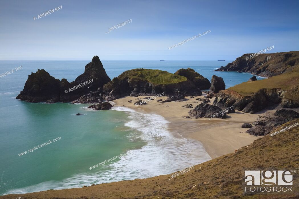 Stock Photo: A view from the cliff top of Kynance Cove on Cornwall's Lizard Peninsular. The image was captured in mid March, when the ebb of a spring tide revealed the sand.