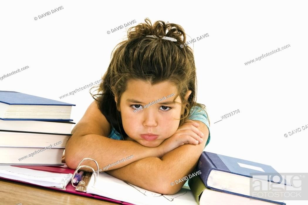 Stock Photo: Child very up set while working on homework on white background.